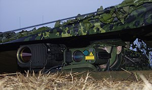 Artillery observer - Danish artillery observer using a thermal imaging camera and a laser rangefinder in a live fire exercise