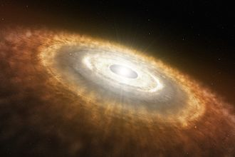 Accretion (astrophysics) - Artist's impression of a protoplanetary disk showing a young star at its center