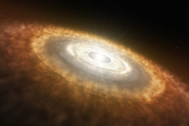 640px-Artist%E2%80%99s_Impression_of_a_Baby_Star_Still_Surrounded_by_a_Protoplanetary_Disc.jpg