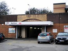 "The entrance to a train station with a sign saying ""Ashton"" above the entrance"