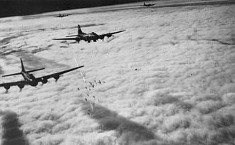 Defence of the Reich - Boeing B-17F bombing through overcast — Bremen, Germany, on 13 November 1943.
