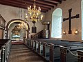 BORRE KIRKE medieval church Horten Norway 2021-07-08 Interior Altertavle Abel Schrøder 1665 Lysekrone chandeliers Prekestol pulpit c 1600 Borrekorset Borre Cross Benkerader pews Kiste coffin etc IMG 7972.jpg