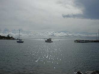 Bahía de Ponce - Partial view of Bahia de Ponce, with Isla de Gatas on the left, Isla Cardona on the far background and Punta Peñoncillo on the right (photo taken looking WSW from La Guancha)