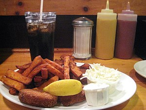 Crab cake - Crab cakes with sweet potato fries and cole slaw, as served at a Massachusetts restaurant