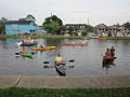 Bayou 4th Canoists Watching the Band.JPG