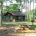 Bear Creek Lake State Park - picnic table and grill, picnic shelter near lake (25607907928).jpg
