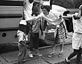 Bettie Norman Hands Out Beenies, St. Louis Voluntary Service, 1965 (15306074263).jpg