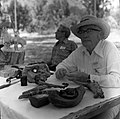 Bill Miller carving a peach pit creature at the first annual Folklife Festival, Zion National Park Nature Center, September 1977 (cb7b1a218403491bbf7c219a91fda352).jpg