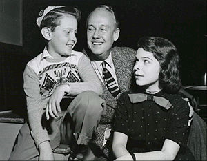 "Paul McGrath (actor) - McGrath (center) as Dr. Martin Allison in the radio comedy My Son Jeep.  Also pictured are Bobby Alford (son ""Jeep"") and Joan Lazer (daughter Peggy)."