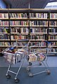 Books in a shopping cart in a library - 8457.jpg