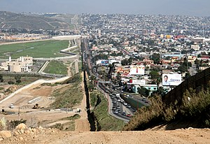 Mexico–United States barrier - Border fence between San Diego's border patrol offices in California (left) and Tijuana, Mexico (right)