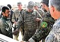 Brig. Gen. Tom Cosentino shakes hands with a worker at the Afghan National Armys 205th Corps maintenance bay at Camp Hero (6225240919).jpg