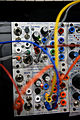 Buchla Electronic Musical Instruments (BEMI) 225h MIDI and CV Interface, 202h Multiples and Utilities - 2014 NAMM Show.jpg