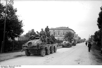 15th Panzergrenadier Division (Wehrmacht) - Reconnaissance unit from 15th Panzer Grenadier Division travels through Italian town