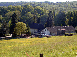 Bergisches Land - view on the woods of Burg with a typical Bergisches farmerhouse