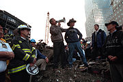 """Bush addresses rescue workers at Ground Zero in New York, September 14, 2001: """"I can hear you. The rest of the world hears you. And the people who knocked these buildings down will hear all of us soon."""""""