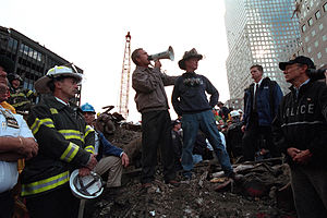 "U-S-A! - Original caption of this photograph read: ""Standing upon the ashes of the worst terrorist attack on American soil, Sept. 14, 2001, President Bush pledges that the voices calling for justice from across the country will be heard. Responding to the Presidents' words, rescue workers cheer and chant, ""U.S.A, U.S.A."" """