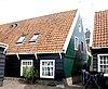 foto van Houten huis in het verlengde van het vorige, met eenvoudige topgevel