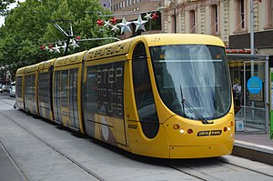 Melbourne tram route 96 - C2 class tram at the Spring Street stop on Bourke Street