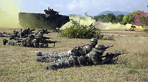 Malaysian Armed Forces -  Soldiers from the Malaysian Army 9th Royal Malay Regiment with a M4 Carbine carry out a beach assault with US Marines during a combined amphibious landing exercise on the final day of CARAT Malaysia 2009.