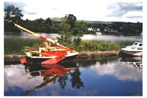 Donald Attig - Berths for a family, enclosed toilet room, cast iron heating stove – not your standard rowboat!