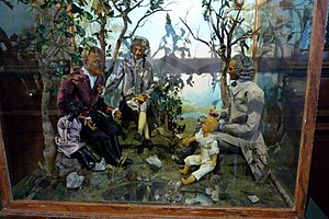 Wax museum - Wax museum in 1792 with the three fathers of the French Revolution, Franklin, Voltaire and Rousseau, installed at Elysium. (musée de la Révolution française)