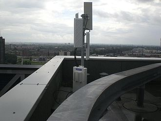 Point-to-multipoint communication - A point-to-multipoint radio base station manufactured by CableFree installed for a wireless internet service provider in Rotterdam.  The station has four radio interfaces each connected to a separate sector antenna, each providing 90 degrees coverage. Within 20 km of this base station, customer-premises equipment with high gain directional antennas are installed on sites which can then connect to the base station to receive broadband data connections of typically 10–200 Mbit/s capacity.