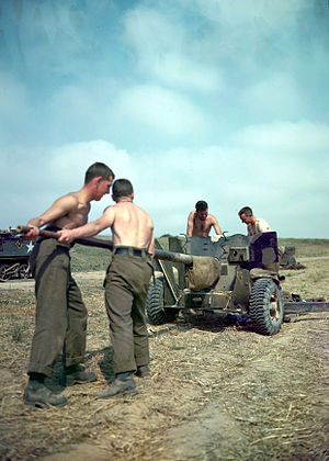 Ordnance QF 6-pounder - A Canadian gun crew performing maintenance of the bore on the 6-pounder.
