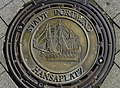 Cast metal manhole cover - Dortmund Hansaplatz, displays a 'Hansakogge' (typical ship of the Hanseatic League) 2019-10-12.jpg