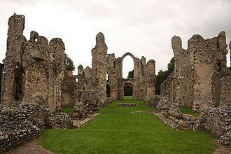 Pulpitum - The 12th century ruined church of Castle Acre Priory looking west from the site of the High Altar. The foundations of two transverse screens can be seen. The closer was the pulpitum screen (which was attached to the choir stalls); the further was the rood screen, which had the altar of the Holy Cross attached to its western face.