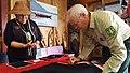 Charles Streuli sews a button onto a Tlingit blanket.jpg