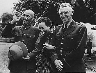 Chiang and his wife Soong Mei-ling sharing a laugh with U.S. Lieutenant General Joseph W. Stilwell, Burma, April 1942 Chiang Kai Shek and wife with Lieutenant General Stilwell.jpg