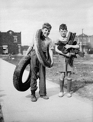 Recycling in Canada - Two boys in Montreal in April, 1942 collect rubber tires and boots to be recycled as part of Canada's war effort.