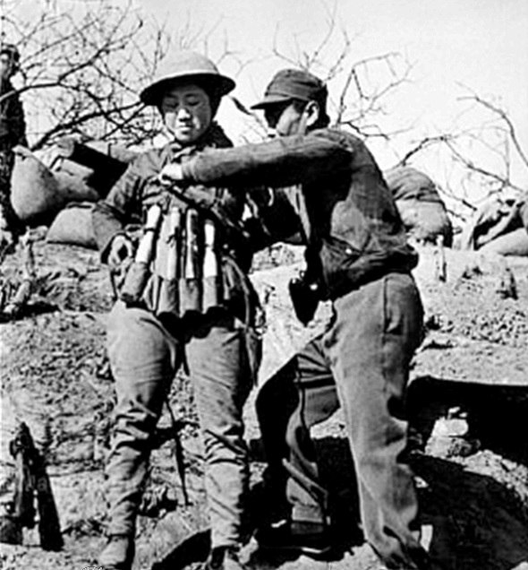 Chinese infantry soldier preparing a suicide vest of Model 24 hand grenades at the Battle of Taierzhuang against Japanese Tanks