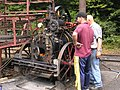 Clayton & Shuttleworth 3NHP portable engine 44141 'Olive' (1911) on big wheel, Hollycombe, Liphook 3.8.2004 P8030037 (10353632765).jpg