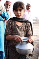 Collecting clean water in rural Sindh (5367575654).jpg