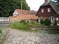 Cottage at Bernard's Ford on the dry River Lambourn, Eastbury, Berkshire.jpg