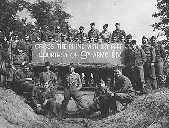 9th Armored Division (United States) - On October 13, 1945, the 9th Armored Division was inactivated in Newport News, Virginia. On that day, members of the division pose with the original sign they posted on the Ludendorff Bridge on March 8, 1945 after it was unexpectedly captured intact, opening a bridgehead into Germany three weeks earlier than planned.