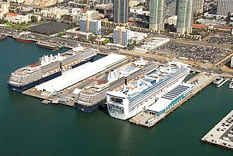 Broadway Pier, San Diego - Broadway Pier (right of third cruise ship) as seen from the air in October 2012. The pier includes a cruise ship terminal added in 2010.