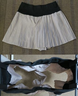 Culottes - White pleated culottes with an interior view showing the leg separation