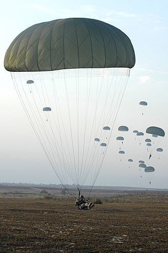 Paratrooper - U.S. Army paratroopers with the 82nd Airborne Division parachute from a C-130 Hercules aircraft during Operation Toy Drop 2007 at Pope Air Force Base