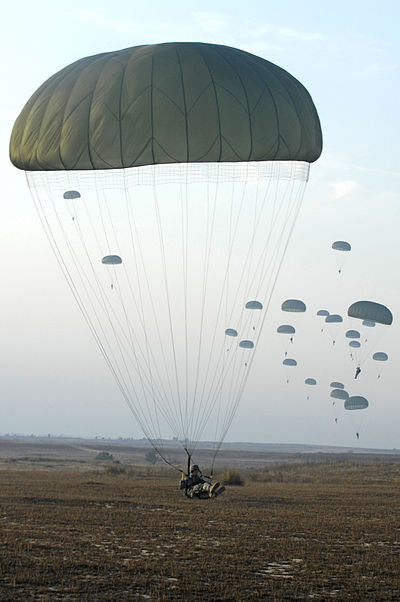 U.S. Army paratroopers with the 82nd Airborne Division parachute from a C-130 Hercules aircraft during Operation Toy Drop 2007 at Pope Air Force Base Defense.gov photo essay 071208-F-5888B-041.jpg