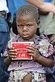 Distributing food in Congo refugee camp.jpeg