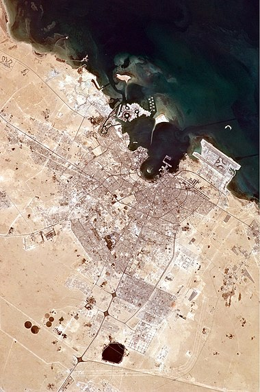 A view of Doha from the International Space Station in 2010 highlights the rapid development the city underwent since the discovery of oil in the 1960s. Doha, Qatar.JPG