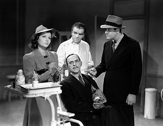 Boris Karloff - L-R: Marjorie Reynolds, Boris Karloff (seated), Raymond Hatton and Grant Withers in Doomed to Die (1940)