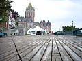 Dufferin Terrace boardwalk with booksellers tents and Chateau Frontenac behind 2005.jpg