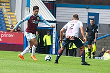 Dwight McNeil looks to take a Montpellier player on in pre-season for Burnley