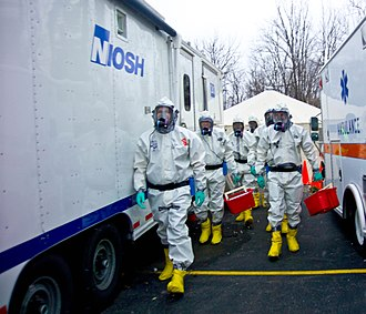 Emergency management - A team of emergency responders performs a training scenario involving anthrax.