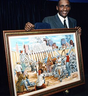 "Ernie Barnes - With ""In Remembrance"" painting. Courtesy of the Ernie Barnes Family Trust."