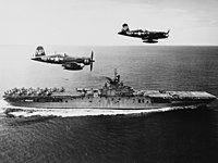 F4U-5N Corsairs of VC-3 fly past USS Boxer (CV-21) off Korea on 4 September 1951 (80-G-433005).jpg